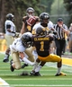 Sep 7, 2013; Laramie, WY, USA; Wyoming Cowboys wide receiver Jalen Claiborne (1) tries to make a catch in front of Idaho Vandals cornerbacks Jordan Grabski (47) and Delency Parham (27) during the first quarter at War Memorial Stadium. Mandatory Credit: Troy Babbitt-USA TODAY Sports