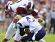 Sep 7, 2013; Starkville, MS, USA; Mississippi State Bulldogs defensive lineman Ryan Brown (48) tackles Alcorn State Braves running back Anthony Williams III (4)  at Davis Wade Stadium. Mandatory Credit: Marvin Gentry-USA TODAY Sports