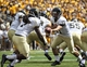 Sep 7, 2013; Laramie, WY, USA; Idaho Vandals quarterback Chad Chalich (11) hands off the football to running back James Baker (7) against the Wyoming Cowboys during the first quarter at War Memorial Stadium. Mandatory Credit: Troy Babbitt-USA TODAY Sports