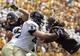 Sep 7, 2013; Laramie, WY, USA; Idaho Vandals offensive lineman Calvin White (63) blocks Wyoming Cowboys linebacker Sonny Puletasi (12) during the first quarter at War Memorial Stadium. Mandatory Credit: Troy Babbitt-USA TODAY Sports