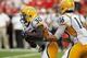 Sep 7, 2013; Lincoln, NE, USA; Southern Mississippi Golden Eagles quarterback Allan Bridgford (16) hands off to running back Jalen Richard (30) against the Nebraska Cornhuskers in the first quarter at Memorial Stadium. Mandatory Credit: Bruce Thorson-USA TODAY Sports