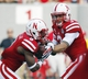 Sep 7, 2013; Lincoln, NE, USA; Nebraska Cornhuskers quarterback Taylor Martinez (3) hands off to running back Ameer Abdullah (8) against Southern Mississippi Golden Eagles in the first quarter at Memorial Stadium. Mandatory Credit: Bruce Thorson-USA TODAY Sports