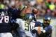 Sep 7, 2013; Charlottesville, VA, USA; Oregon Ducks defensive end Tony Washington (91) forces a fumble by Virginia Cavaliers quarterback David Watford (5) in the third quarter. The Ducks defeated the Virginia Cavaliers 59-10 at Scott Stadium. Mandatory Credit: Bob Donnan-USA TODAY Sports