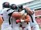 Sep 7, 2013; Raleigh, NC, USA; Richmond Spiders tight end Sam Roller (second from right) is congratulated by teammates after a first half touchdown against the North Carolina State Wolfpack at Carter Finley Stadium. Mandatory Credit: Rob Kinnan-USA TODAY Sports