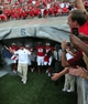 Sep 7, 2013; Raleigh, NC, USA; North Carolina State Wolfpack head coach Dave Doeren (in white) leads his team onto the field against the Richmond Spiders at Carter Finley Stadium. Mandatory Credit: Rob Kinnan-USA TODAY Sports