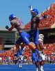 Sep 7, 2013; Boise, ID, USA; Boise State Broncos wide receiver Aaron Burks (18) and  wide receiver Kirby Moore (34) celebrate a touchdown during the second half against the Tennessee Martin Skyhawks at Bronco Stadium. Boise State defeated Tennessee Martin 63-14. Mandatory Credit: Brian Losness-USA TODAY Sports