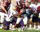 Sep 7, 2013; Starkville, MS, USA;  Mississippi State Bulldogs running back Ashton Shumpert (32) is grabbed by Alcorn State Braves defensive lineman Jamil Johnson (91) at Davis Wade Stadium.  The Bulldogs defeated the Braves 51-7. Mandatory Credit: Marvin Gentry-USA TODAY Sports
