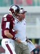 Sep 7, 2013; Starkville, MS, USA;  Mississippi State Bulldogs head coach Dan Mullen talks to quarterback Justin Cox (19) during the game against the Alcorn State Braves at Davis Wade Stadium.  The Bulldogs defeated the Braves 51-7. Mandatory Credit: Marvin Gentry-USA TODAY Sports