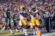 Sep 7, 2013; Baton Rouge, LA, USA; LSU Tigers wide receiver Odell Beckham (3) is congratulated by wide receiver Jarvis Landry (80) after scoring a touchdown against the UAB Blazers during the first quarter at Tiger Stadium. Mandatory Credit: Crystal LoGiudice-USA TODAY Sports