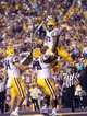 Sep 7, 2013; Baton Rouge, LA, USA; LSU Tigers running back Kenny Hilliard (27) is congratulated by teammates Greg Gilmore (99) and tight end Logan Stokes (84) after a touchdown against the UAB Blazers during the first quarter at Tiger Stadium. Mandatory Credit: Crystal LoGiudice-USA TODAY Sports
