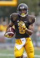 Sep 7, 2013; Laramie, WY, USA; Wyoming Cowboys wide receiver Robert Herron (6) runs against the Idaho Vandals during the second quarter at War Memorial Stadium. The Cowboys defeated the Vandals 42-10. Mandatory Credit: Troy Babbitt-USA TODAY Sports
