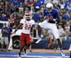 Sep 7, 2013; Lawrence, KS, USA; Kansas Jayhawks wide receiver Justin McCay (19) catches a touchdown pass against the South Dakota Coyotes in the first half at Memorial Stadium. Mandatory Credit: John Rieger-USA TODAY Sports