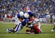 Sep 7, 2013; Lawrence, KS, USA; South Dakota Coyotes quarterback Josh Vander Maten (7) is tackled by Kansas Jayhawks linebacker Courtney Arnick (58) and defensive lineman Keba Agostinho (96) in the first half at Memorial Stadium. Mandatory Credit: John Rieger-USA TODAY Sports