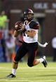 Sep 7, 2013; Oxford, MS, USA; Southeast Missouri State Redhawks quarterback Scott Lathrop (17) drops back for a pass during the first half against the Mississippi Rebels at Vaught-Hemingway Stadium. Mandatory Credit: Spruce Derden-USA TODAY Sports