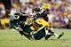 Sep 7, 2013; Baton Rouge, LA, USA; UAB Blazers cornerback Cortez Webb (14) and safety Nick Jackson (6) tackle LSU Tigers wide receiver Jarvis Landry (80) as he carries the ball during the second quarter at Tiger Stadium. Mandatory Credit: Crystal LoGiudice-USA TODAY Sports