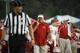 Sep 7, 2013; Lawrence, KS, USA; South Dakota Coyotes head coach Joe Glenn (right) talks to head linesman Mike Moeller (left) against the Kansas Jayhawks in the first half at Memorial Stadium. Mandatory Credit: John Rieger-USA TODAY Sports