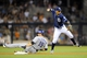 Sep 7, 2013; San Diego, CA, USA; San Diego Padres shortstop Ronny Cedeno (3) throws to first after avoiding a slide by Colorado Rockies center fielder Charlie Blackmon (19) during the eighth inning at Petco Park. Mandatory Credit: Christopher Hanewinckel-USA TODAY Sports