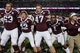 Sep 7, 2013; College Station, TX, USA; Members of the Texas A&M Aggies including Ben Malena (1) celebrate after defeating the Sam Houston State Bearkats 65-28 at Kyle Field. Mandatory Credit: Troy Taormina-USA TODAY Sports