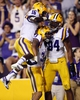 Sep 7, 2013; Baton Rouge, LA, USA; LSU Tigers wide receiver Odell Beckham (3) is congratulated by teammates defensive back Tre'Davious White (16) and Danielle Hunter (94) after a 100 yard return on a missed field goal attempt by UAB Blazers in the second half at Tiger Stadium. LSU defeated UAB 56-17. Mandatory Credit: Crystal LoGiudice-USA TODAY Sports