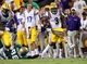 Sep 7, 2013; Baton Rouge, LA, USA; LSU Tigers wide receiver Odell Beckham (3) carries the ball past UAB Blazers tight end Kennard Backman (86) for a 100 yard return on a missed field goal attempt by UAB in the second half at Tiger Stadium. LSU defeated UAB 56-17. Mandatory Credit: Crystal LoGiudice-USA TODAY Sports
