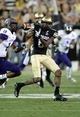 Sep 7, 2013; Boulder, CO, USA; Colorado Buffaloes wide receiver Paul Richardson (6) prepares to make a reception as he is defended by Central Arkansas Bears defensive back Marcus Peters (19) in the fourth quarter at Folsom Field. The Buffaloes defeated the Bears 38-24. Mandatory Credit: Ron Chenoy-USA TODAY Sports