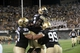 Sep 7, 2013; Boulder, CO, USA; Colorado Buffaloes defensive back Kenneth Crawley (2) is congratulated for his late fourth quarter interception by defensive lineman Nate Bonsu (99) and defensive lineman Justin Solis (57) against the Central Arkansas Bears at Folsom Field. The Buffaloes defeated the Bears 38-24. Mandatory Credit: Ron Chenoy-USA TODAY Sports