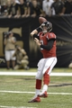 Sep 8, 2013; New Orleans, LA, USA; Atlanta Falcons quarterback Matt Ryan (2) passing off his back foot under pressure from the New Orleans Saints defense during the third quarter at the Mercedes-Benz Superdome. Mandatory Credit: John David Mercer-USA TODAY Sports