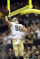 Sep 8, 2013; New Orleans, LA, USA; New Orleans Saints tight end Jimmy Graham (80) celebrates his touchdown against the Atlanta Falcons in the endzone during the third quarter at the Mercedes-Benz Superdome. Mandatory Credit: John David Mercer-USA TODAY Sports