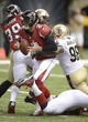 Sep 8, 2013; New Orleans, LA, USA; Atlanta Falcons quarterback Matt Ryan (2) gets sacked for a loss by New Orleans Saints linebacker Parys Haralson (98) during the third quarter at the Mercedes-Benz Superdome. Mandatory Credit: John David Mercer-USA TODAY Sports