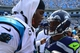 Sep 8, 2013; Charlotte, NC, USA; Carolina Panthers quarterback Cam Newton (1) talks with Seattle Seahawks quarterback Russell Wilson (3) after the game. The Seahawks defeated the Panthers 12-7 at Bank of America Stadium. Mandatory Credit: Bob Donnan-USA TODAY Sports