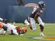 Sep 8, 2013; Chicago, IL, USA; Chicago Bears running back Michael Bush (29) runs past Cincinnati Bengals linebacker Emmanuel Lamur (59) during the second half at Soldier Field. Chicago won 24-21. Mandatory Credit: Dennis Wierzbicki-USA TODAY Sports