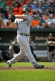 Sep 8, 2013; Baltimore, MD, USA; Chicago White Sox designated hitter Adam Dunn (32) bats in the seventh inning against the Baltimore Orioles at Oriole Park at Camden Yards. The White Sox defeated the Orioles 4-2. Mandatory Credit: Joy R. Absalon-USA TODAY Sports