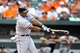 Sep 8, 2013; Baltimore, MD, USA; Chicago White Sox left fielder Dayan Viciedo (24) singles in the eighth inning against the Baltimore Orioles at Oriole Park at Camden Yards. The White Sox defeated the Orioles 4-2. Mandatory Credit: Joy R. Absalon-USA TODAY Sports