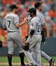 Sep 8, 2013; Baltimore, MD, USA; Chicago White Sox teammates Jeff Keppinger (7) and White Sox Leury Garcia (28) celebrate after the game against the Baltimore Orioles at Oriole Park at Camden Yards. The White Sox defeated the Orioles 4-2. Mandatory Credit: Joy R. Absalon-USA TODAY Sports