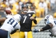 Sep 8, 2013; Pittsburgh, PA, USA; Pittsburgh Steelers quarterback Ben Roethlisberger (7) passes under pressure against the Tennessee Titans during the fourth quarter at Heinz Field. The Tennessee Titans won 16-9. Mandatory Credit: Charles LeClaire-USA TODAY Sports