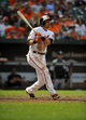 Sep 8, 2013; Baltimore, MD, USA; Baltimore Orioles second baseman Ryan Flaherty (3) doubles in the seventh inning against the Chicago White Sox at Oriole Park at Camden Yards. The White Sox defeated the Orioles 4-2. Mandatory Credit: Joy R. Absalon-USA TODAY Sports