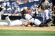 Sep 8, 2013; San Diego, CA, USA; San Diego Padres center fielder Reymond Fuentes (27) collides with Colorado Rockies catcher Jordan Pacheco (15) while trying to score on a passed ball during the third inning at Petco Park. Mandatory Credit: Christopher Hanewinckel-USA TODAY Sports