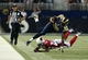 Sep 8, 2013; St. Louis, MO, USA; St. Louis Rams tight end Jared Cook (89) is tackled by Arizona Cardinals cornerback Jerraud Powers (25) during the second half at Edward Jones Dome. St. Louis defeated Arizona 27-24. Mandatory Credit: Jeff Curry-USA TODAY Sports