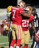Sep 8, 2013; San Francisco, CA, USA; San Francisco 49ers quarterback Colin Kaepernick (7) celebrates with running back Frank Gore (21) after scoring a touchdown against the Green Bay Packers during the fourth quarter at Candlestick Park. The San Francisco 49ers defeated the Green Bay Packers 34-28. Mandatory Credit: Kelley L Cox-USA TODAY Sports