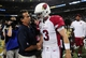 Sep 8, 2013; St. Louis, MO, USA; St. Louis Rams head coach Jeff Fisher talks with Arizona Cardinals quarterback Carson Palmer (3) after a game at Edward Jones Dome. St. Louis defeated Arizona 27-24. Mandatory Credit: Jeff Curry-USA TODAY Sports