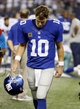 Sep 8, 2013; Arlington, TX, USA; New York Giants quarterback Eli Manning (10) leaves the field after the game against the Dallas Cowboys  at AT&T Stadium.  The Dallas Cowboys beat the New York Giants 36-31. Mandatory Credit: Tim Heitman-USA TODAY Sports