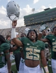 Sep 7, 2013; Waco, TX, USA; Baylor Bears running back Lache Seastrunk (25) celebrates the win over the Buffalo Bulls at Floyd Casey Stadium. The Bears defeated the Bulls 70-13. Mandatory Credit: Jerome Miron-USA TODAY Sports