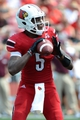 Sep 7, 2013; Louisville, KY, USA; Louisville Cardinals quarterback Teddy Bridgewater (5) looks to pass during the second half against Eastern Kentucky Colonels at Papa John's Cardinal Stadium. Louisville defeated Eastern Kentucky 44-7.  Mandatory Credit: Jamie Rhodes-USA TODAY Sports