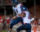 Sep 7, 2013; Las Vegas, NV, USA; Arizona Wildcats quarterback J.J. Denker, left, celebrates with wide receiver Nate Phillips after scoring a 35-yard rushing touchdown during the first quarter of an NCAA football game against the UNLV Rebels at Sam Boyd Stadium. Arizona won the game 58-13. Mandatory Credit: Stephen R. Sylvanie-USA TODAY Sports