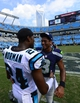 Sep 8, 2013; Charlotte, NC, USA; Seattle Seahawks quarterback Russell Wilson (3) talks with Carolina Panthers cornerback Josh Norman (24) after the game. The Seahawks defeated the Panthers 12-7 at Bank of America Stadium. Mandatory Credit: Bob Donnan-USA TODAY Sports