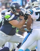 Sep 8, 2013; Charlotte, NC, USA; Seattle Seahawks tackle Breno Giacomini (68) blocks Carolina Panthers defensive end Greg Hardy (76) in the fourth quarter. The Seahawks defeated the Panthers 12-7 at Bank of America Stadium. Mandatory Credit: Bob Donnan-USA TODAY Sports
