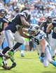 Sep 8, 2013; Charlotte, NC, USA; Seattle Seahawks running back Marshawn Lynch (24) runs as Carolina Panthers middle linebacker Luke Kuechly (59) defends in the fourth quarter. The Seahawks defeated the Panthers 12-7 at Bank of America Stadium. Mandatory Credit: Bob Donnan-USA TODAY Sports