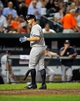 Sep 9, 2013; Baltimore, MD, USA; New York Yankees center fielder Brett Gardner (11) reacts after being called out on strikes in the eighth inning against the Baltimore Orioles at Oriole Park at Camden Yards. The Orioles defeated the Yankees 4-2. Mandatory Credit: Joy R. Absalon-USA TODAY Sports