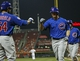 Sep 10, 2013; Cincinnati, OH, USA; Chicago Cubs third baseman Donnie Murphy (8) is congratulated by left fielder Darnell McDonald (54) after hitting a home run during the third inning against the Cincinnati Reds at Great American Ball Park. Mandatory Credit: Frank Victores-USA TODAY Sports