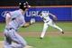 Sep 10, 2013; New York, NY, USA; New York Mets shortstop Omar Quintanilla (3) throws out Washington Nationals first baseman Adam LaRoche (25) during the sixth inning at Citi Field. Mandatory Credit: Joe Camporeale-USA TODAY Sports